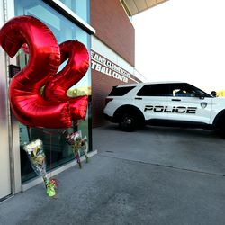 Small memorials for Sophomore defensive back Aaron Lowe, who was shot and killed early Sunday morning have been placed at two locations, one at the scene of the shooting and the other at the Spence and Cleone Eccles Football Center at the University of Utah in Salt Lake City on Sunday, Sept. 26, 2021.