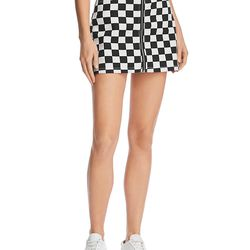 """<a href=""""https://www.bloomingdales.com/shop/product/sunset-spring-checkerboard-denim-mini-skirt-100-exclusive?ID=2825550&CategoryID=1049859#fn=ppp%3Dundefined%26sp%3D1%26rId%3D96%26spc%3D78%26spp%3D64%26rsid%3Dundefined%26smp%3DmatchNone"""">Sunset + Spring denim skirt</a>, $68"""