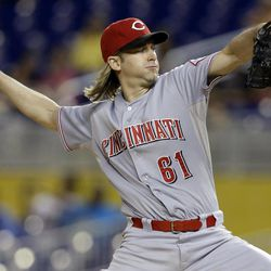 Cincinnati Reds starting pitcher Bronson Arroyo throws in the first inning during a baseball game against the Miami Marlins, Friday, Sept. 14, 2012, in Miami.