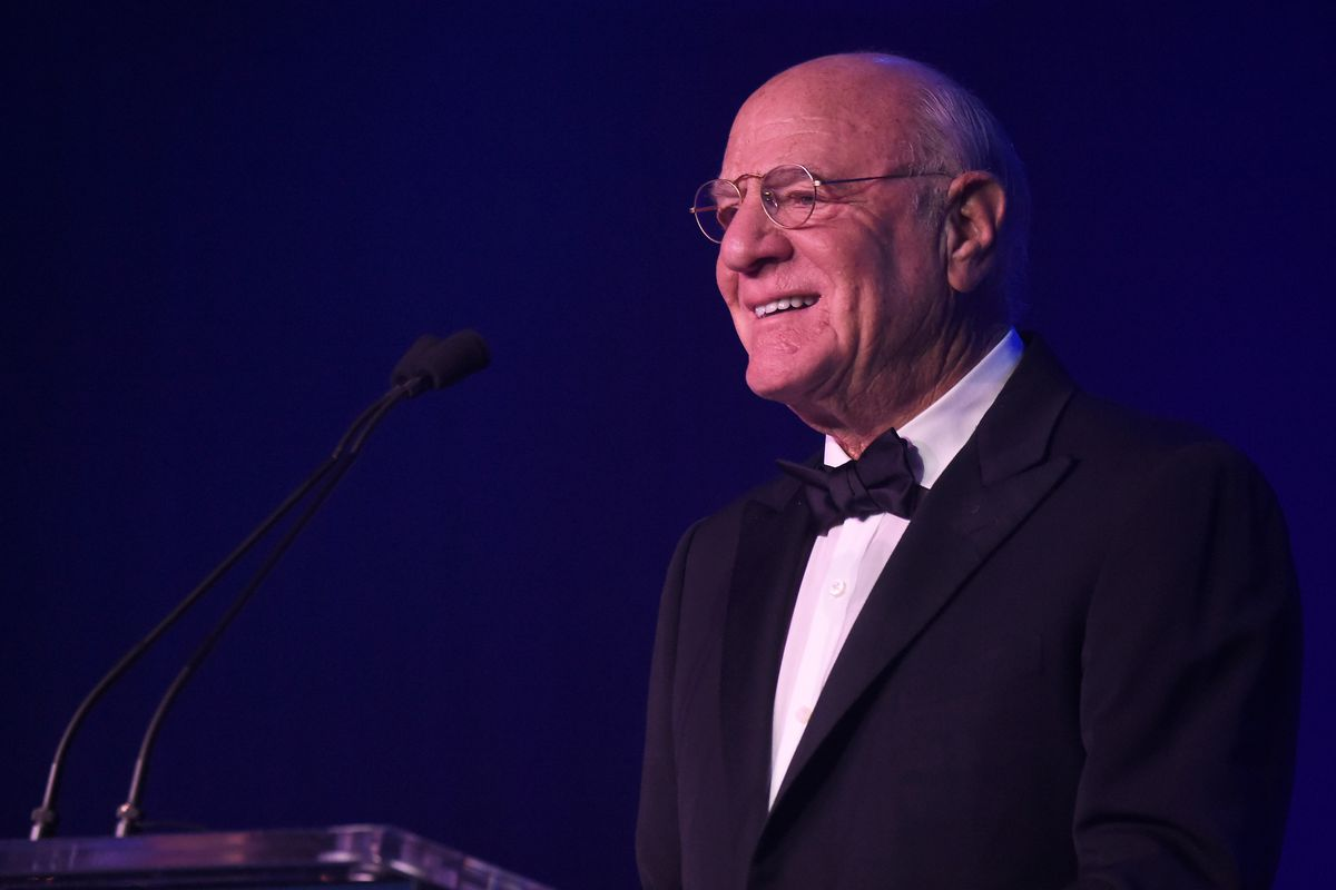 IAC Chairman Barry Diller speaking onstage from behind a podium.