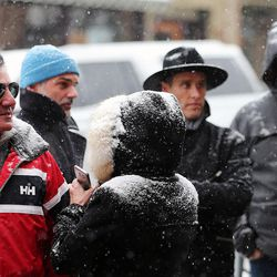 People stand in a line on Main Street in Park City as they attend Sundance on Sunday, Jan., 22, 2017.