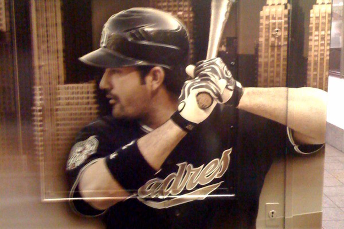 """A picture of Adrian in a New York city subway sent from a Gaslamp Baller's iPhone:  """"TBS is promoting their postseason MLB coverage.  There were no Giants nor Rockies in sight.  I smiled when I saw Big Adrian."""""""