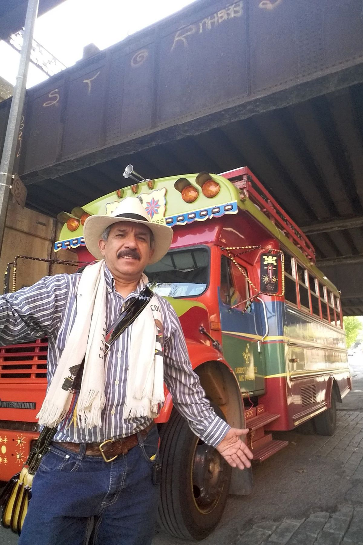 Daniel Bernal hangs out with his Colombian party bus bus at a Bronx Bar.