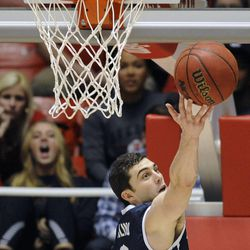 Brigham Young Cougars guard Matt Carlino (2) reaches out for a rebound during a game at the Jon M. Huntsman Center on Saturday, Dec. 14, 2013.