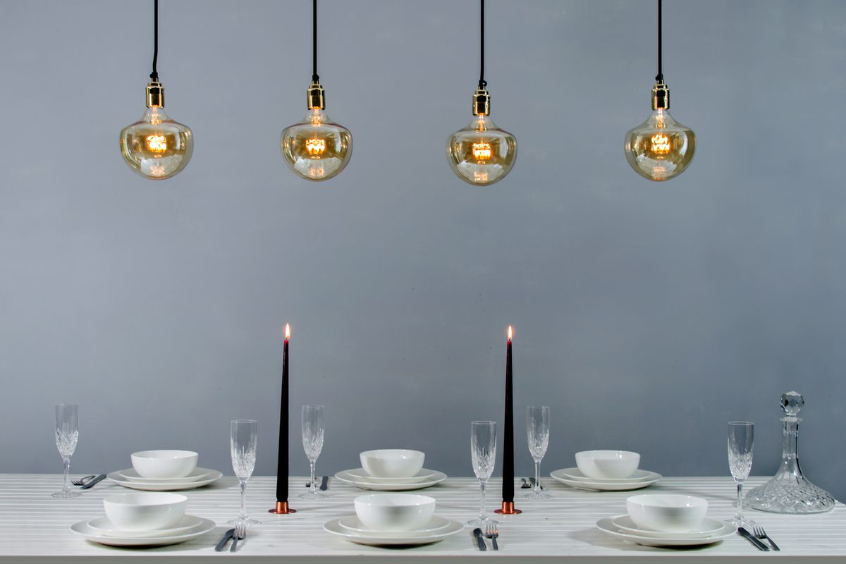 Pendant lights dangling from ceiling above table