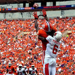 Clemson wide receiver DeAndre Hopkins pulls in a reception for a touchdown while being covered by Ball state's Jason Pinkston in the first half of an NCAA college football game Saturday, Sept. 8, 2012 at Memorial Stadium in Clemson S.C.