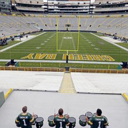Drummers practice at Lambeau Field before an NFL football game between the Green Bay Packers and the Chicago Bears Thursday, Sept. 13, 2012, in Green Bay, Wis.