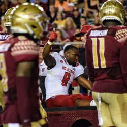 An NC State player gives the thumbs up after suffering a scary injury.