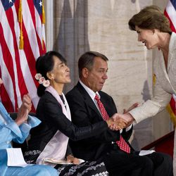 House Democratic Leader Nancy Pelosi, D-Calif., left, and Speaker of the House John Boehner, R-Ohio, sit next to Myanmar democracy leader Aung San Suu Kyi as she is greeted by former first lady Laura Bush, right, during a ceremony to award Suu Kyi with the Congressional Gold Medal at the U.S. Capitol in Washington, Wednesday, Sept. 19, 2012.