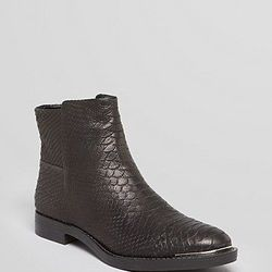 """<a href=""""http://www1.bloomingdales.com/shop/product/enzo-angiolini-booties-emni-ankle"""">Enzo Angiolini booties</a>, $83.44 (were $149)"""