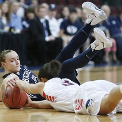 Brigham Young Cougars guard Lexi Eaton (21) and Gonzaga Bulldogs guard Haiden Palmer (3) scramble for the ball during the West Coast Conference championship game in Las Vegas Tuesday, March 11, 2014. BYU lost 71-57.