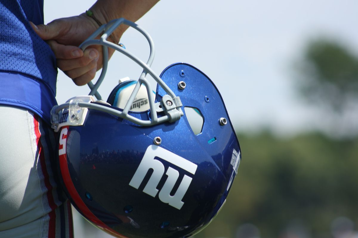 Steve Weatherford holds onto his helmet during New York Giants training camp at UAlbany. (Photo by Ryan Valentine/Big Blue View)
