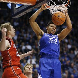 Brigham Young Cougars forward Yoeli Childs (23) slams a dunk against the Utes in Provo on Saturday, Dec. 16, 2017. BYU won 77-65.