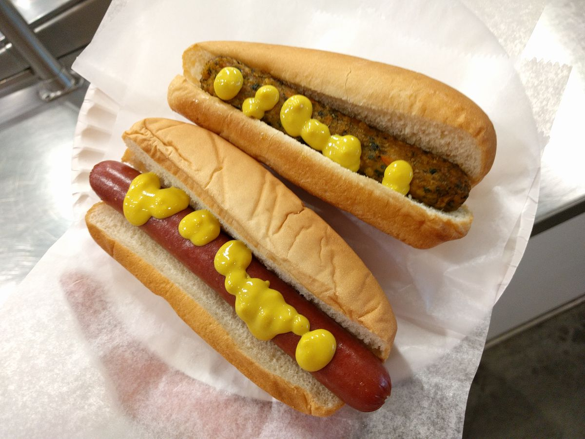 IKEA's vegetarian and meat franks, in buns with dots of mustard.