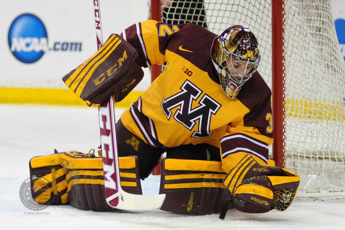 Adam Wilcox gloves a save.