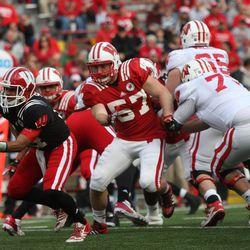 Linebacker Ben Ruechel chases down quarterback Connor Senger.