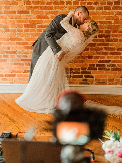 In this photo, Amanda Trocola and Jason Castellente pose a kiss for the cameras.