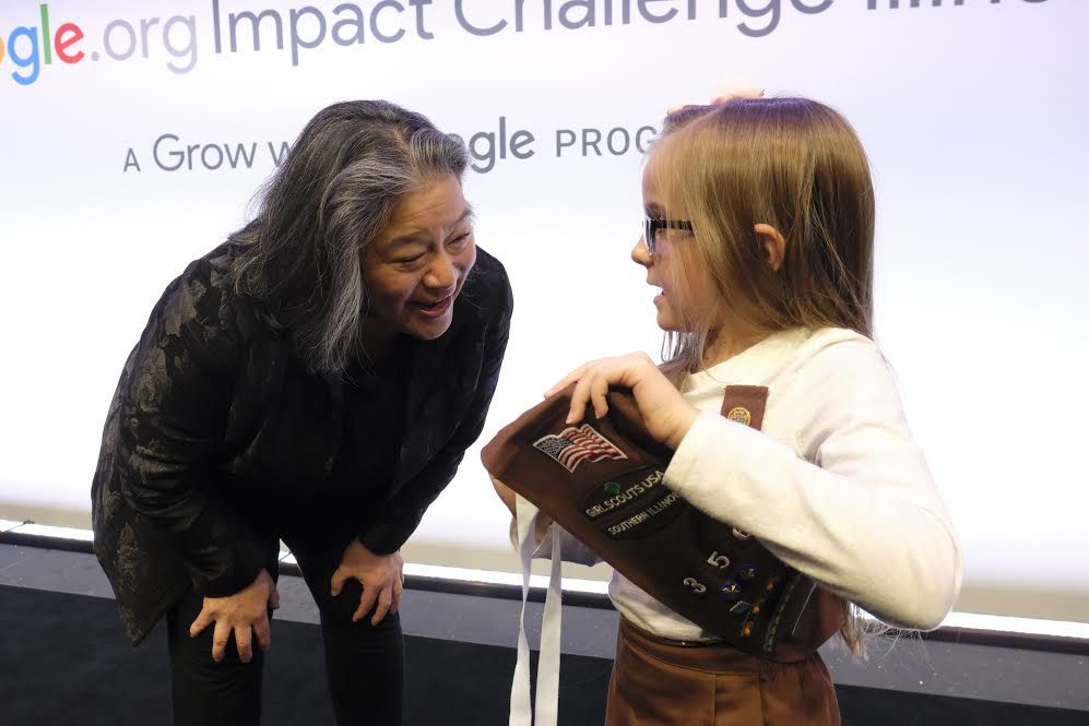 Tina Tchen, former chief of staff to former first lady Michelle Obama, chats with Emma Vrooman, a Brownie with the Girl Scouts of Southern Illinois, one of 10 nonprofits to snag $75,000. Tchen was among the panel of luminaries who judged Impact Challenge