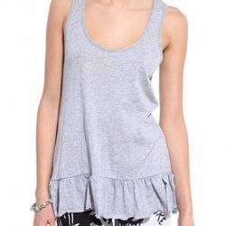 """This <a href=""""http://www.shopakira.com/products/ruffled-hem-tank.html"""">Akira top</a> adds a little dash of femininity to an otherwise edgy outfit."""
