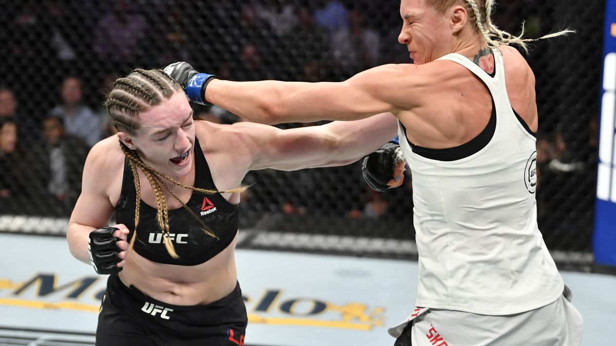 (L-R) Aspen Ladd punches Yana Kunitskaya of Russia in their women's bantamweight bout during the UFC Fight Night event at Capital One Arena on December 07, 2019 in Washington, DC.