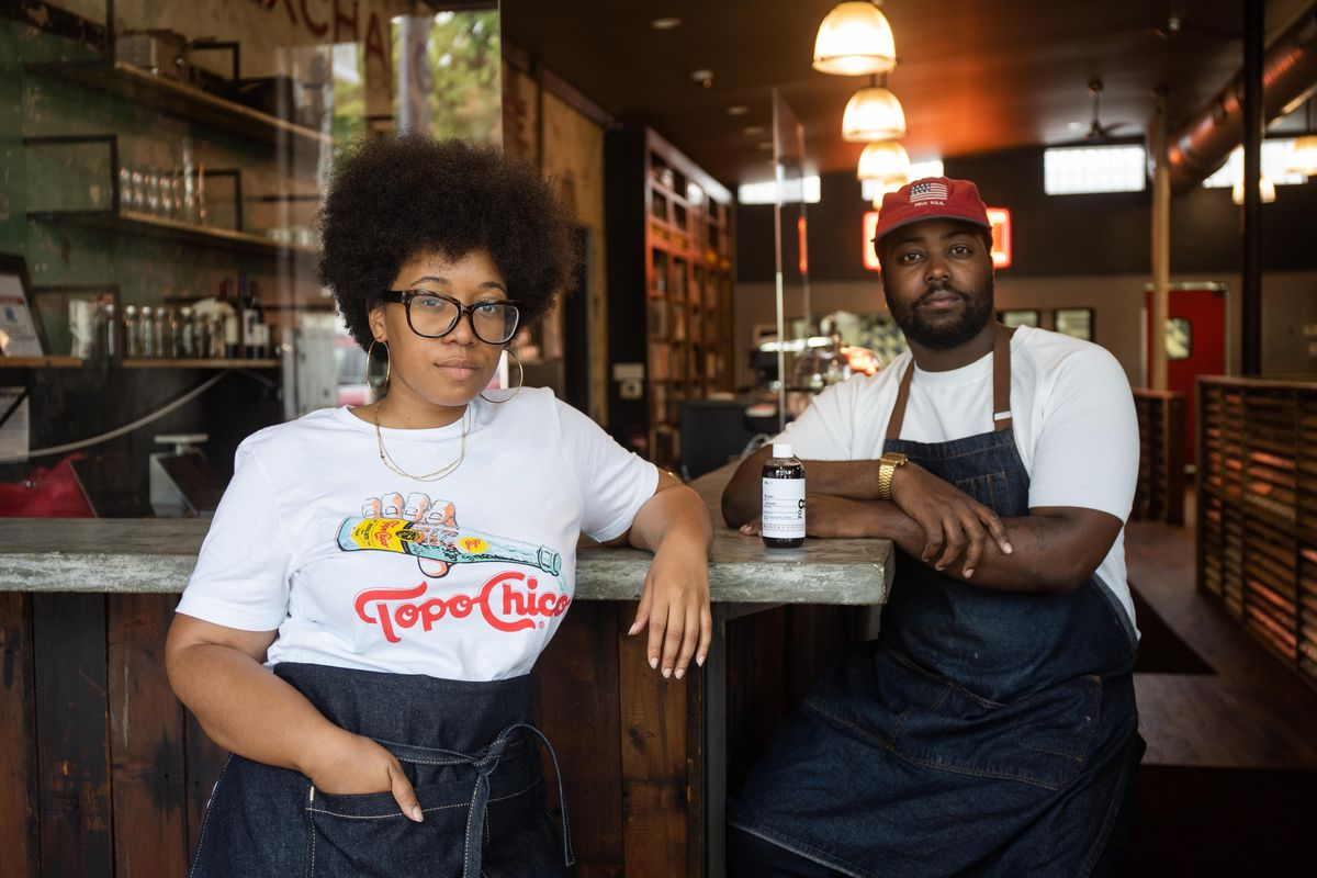 Amanda Harth and Felton Kizer, founders of Monday Coffee Company, pose for a picture at Retreat at Currency Exchange Café, located at 305 E. Garfield Blvd. in the Washington Park neighborhood, Thursday morning, Aug. 19, 2021. Monday Coffee Company received a residency at Retreat at Currency Exchange Café through Rebuild Foundation.