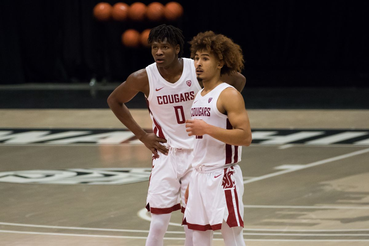 PULLMAN, WA - DECEMBER 2: Washington State center Efe Abogidi (0) and guard Isaac Bonton (10) discuss a play during the second half of the Pac 12 matchup between the Oregon State Beavers and the Washington State Cougars on December 2, 2020, at Beasley Coliseum in Pullman, WA.
