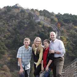 """""""Global Mom"""" author Melissa Dalton-Bradford poses with her husband and two sons at the Great Wall of China."""