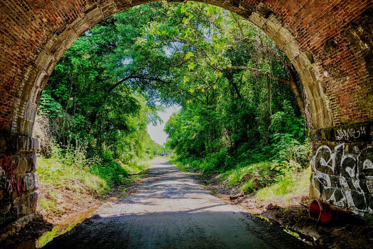 The gravel Southside Trail, as seen from a former railroad tunnel.