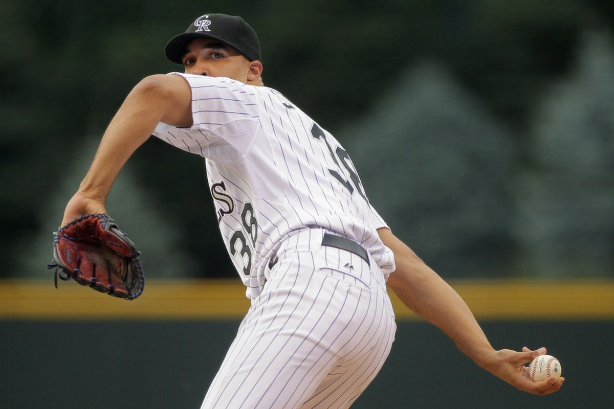 DENVER, CO - JUNE 29:  Starting pitcher Ubaldo Jimenez #38 of the Colorado Rockies delivers against the Chicago White Sox during Interleague play at Coors Field on June 29, 2011 in Denver, Colorado.  (Photo by Doug Pensinger/Getty Images)