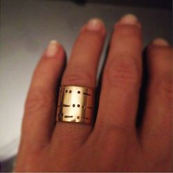 """<strong>Jules Unisex Morse Code Band <a href=""""http://www.shopjules.com/product_info.php?cat_id=4&prod_id=226#.U5Ub1ahX-uY"""">Ring</a> - $200.</strong> Who says you have to go for the cookie-cutter platinum band ring with a honking diamond? Yeah, they look n"""