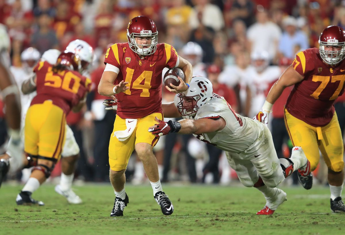 LOS ANGELES, CA:  Stanford Cardinal defensive lineman Harrison Phillips (66) drags down USC Trojans quarterback Sam Darnold (14) during a game at the Los Angeles Memorial Coliseum.
