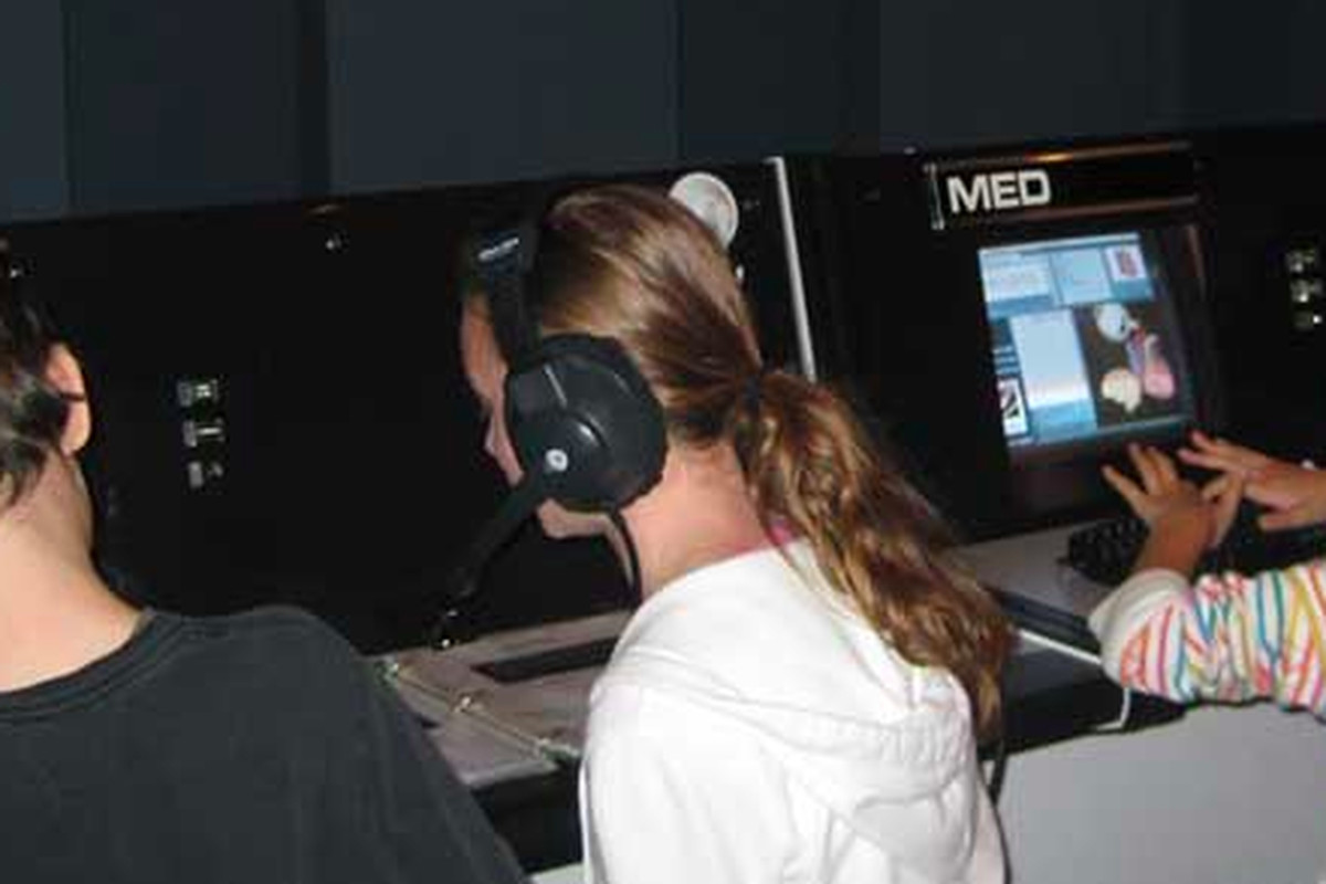 Students simulated space shuttle missions at the Challenger Center.