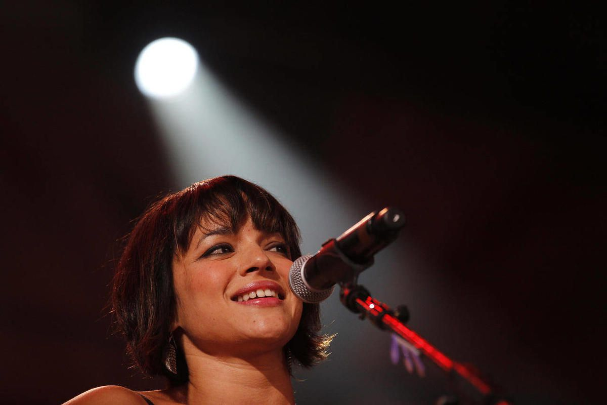 """FILE - In this Oct. 2, 2010 file photo, Norah Jones performs during the 25th anniversary Farm Aid concert in Milwaukee. Jones is unveiling something new at South By Southwest — again. Ten years after she shook Austin and the music world with """"Come Away Wi"""