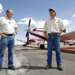 Andy Taylor, Owner of New Frontier Aviation, right, and Wayne Faw talk Monday, July 16, 2012 about how they do their jobs of fighting fires from the air.