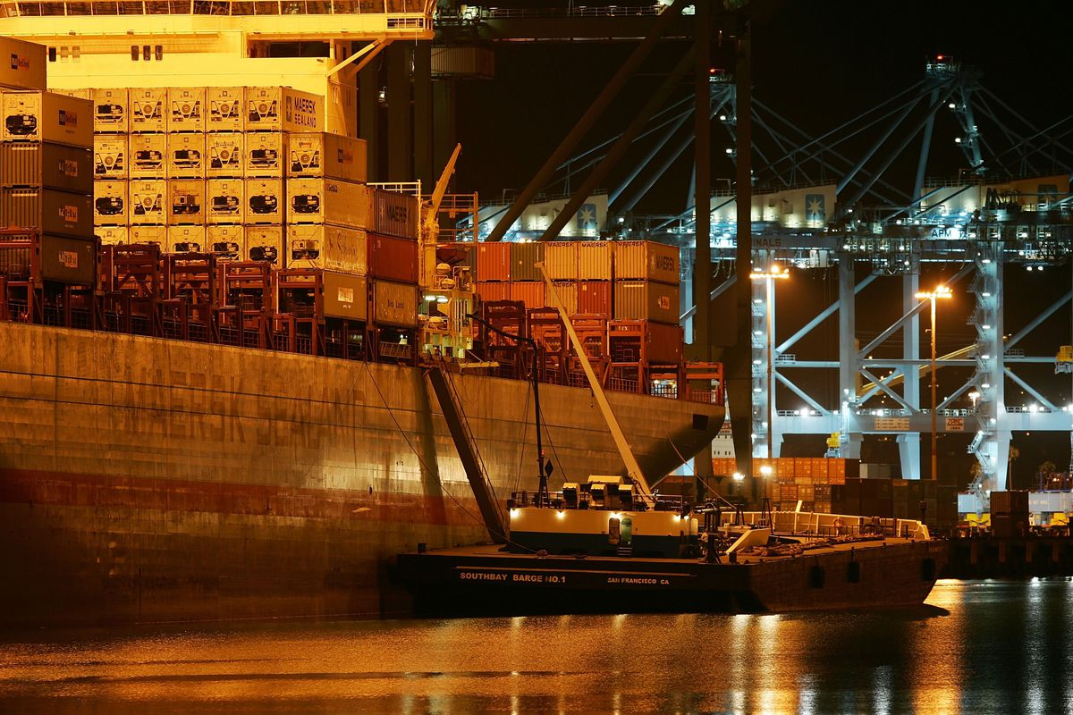 Cranes move shipping containers at the ports of Long Beach and Los Angeles.