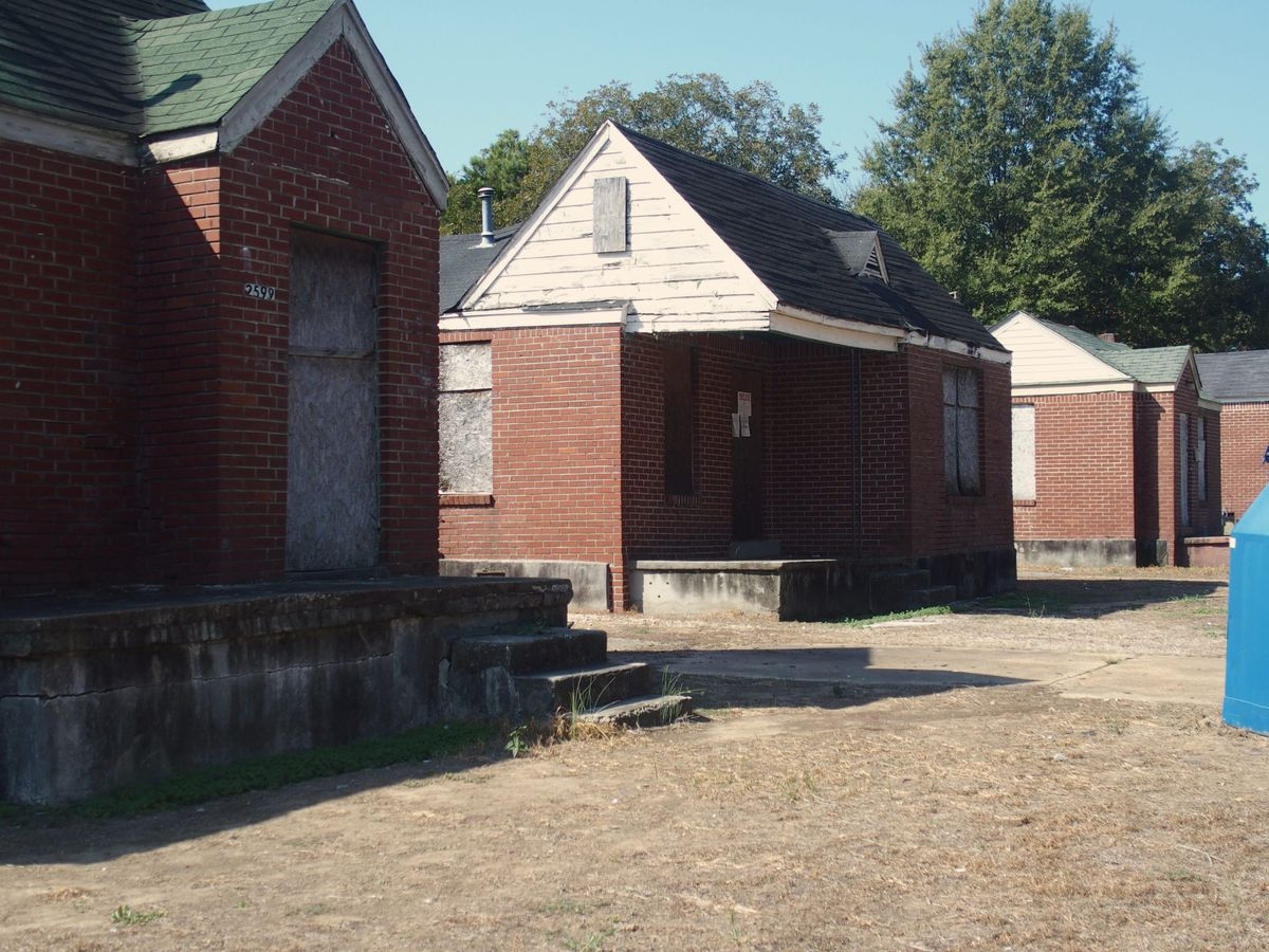 A row of boarded up houses sit across from Dunbar Elementary School in Memphis.