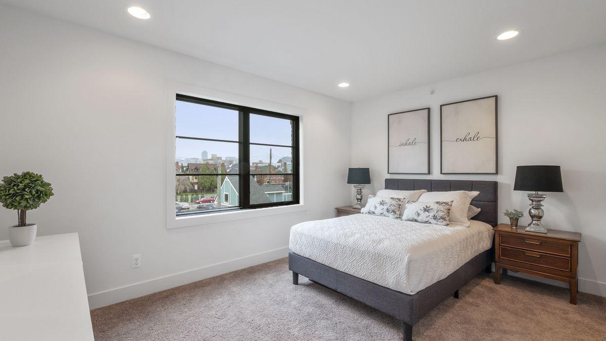 The master bedroom has carpet floors