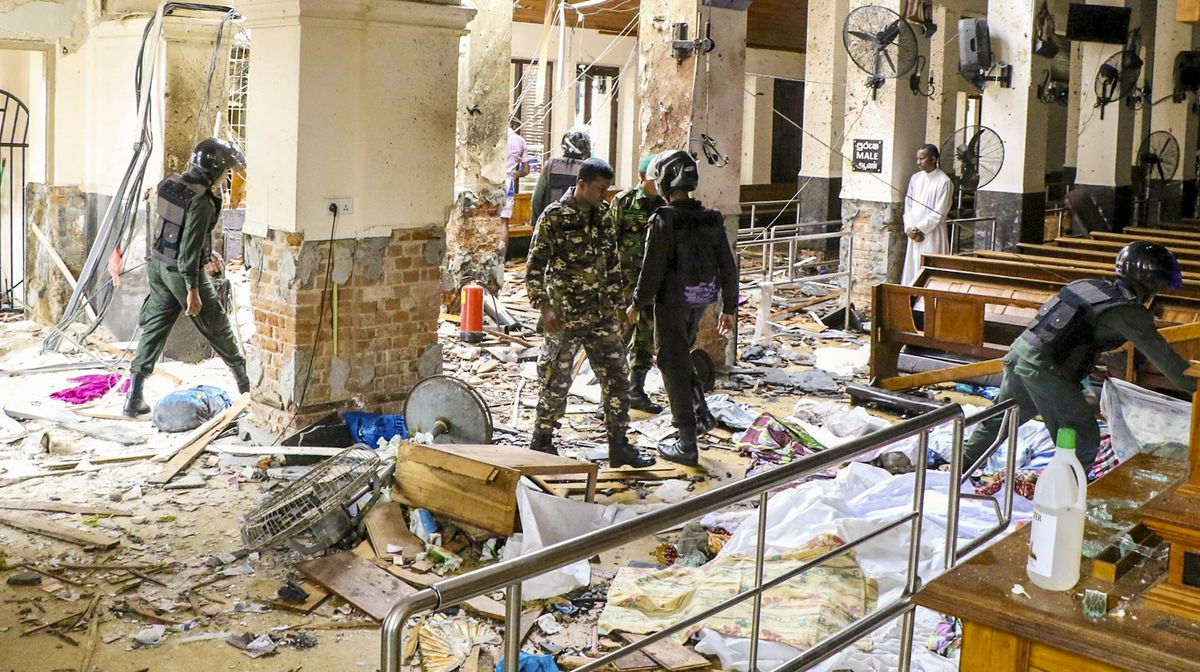 Security forces inspect the St. Anthony's Church.