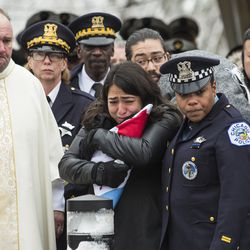 Officer Jimenez's wife, Crystal Garcia watches as his casket is placed in the hearse. | Ashlee Rezin/Sun-Times