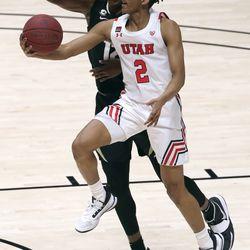 Utah Utes guard Ian Martinez (2) shoots in front of Colorado Buffaloes forward Jabari Walker (12) during a men's basketball game at the Huntsman Center in Salt Lake City on Monday, Jan. 11, 2021. Utah lost 58-65.