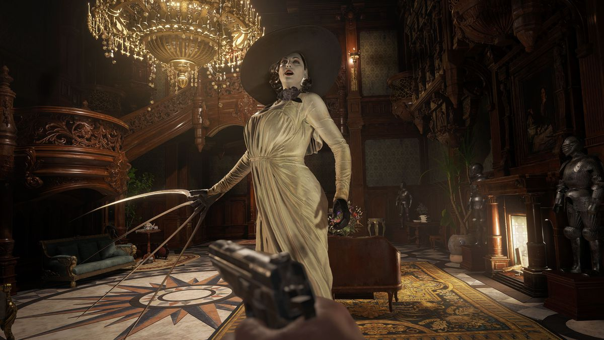 The menacing tall Lady Dimitrescu laughs under a chandelier in Resident Evil Village. Her right hand extends into long, Edward Scissorhands-like claws.
