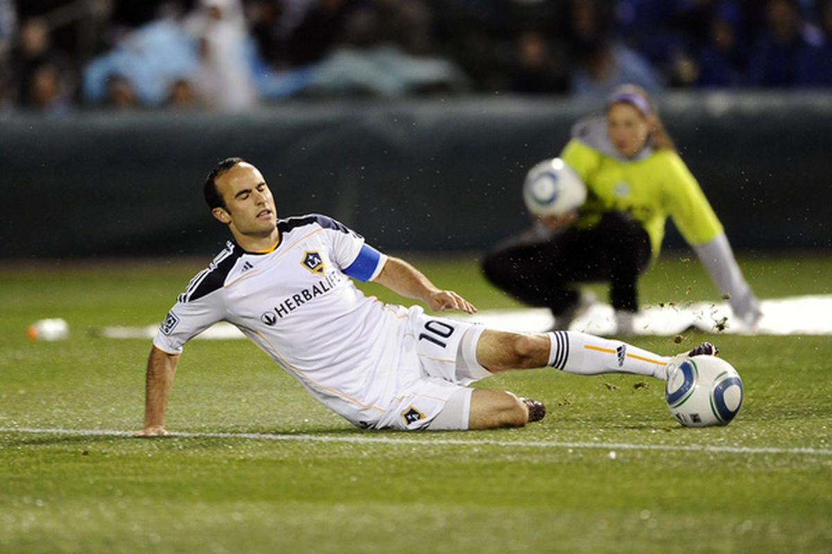 This is how Landon Donovan sleeps at night. (Photo by G. Newman Lowrance/Getty Images)