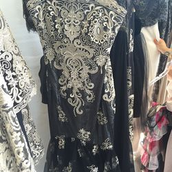 Black and white lace mid-length gown, $100