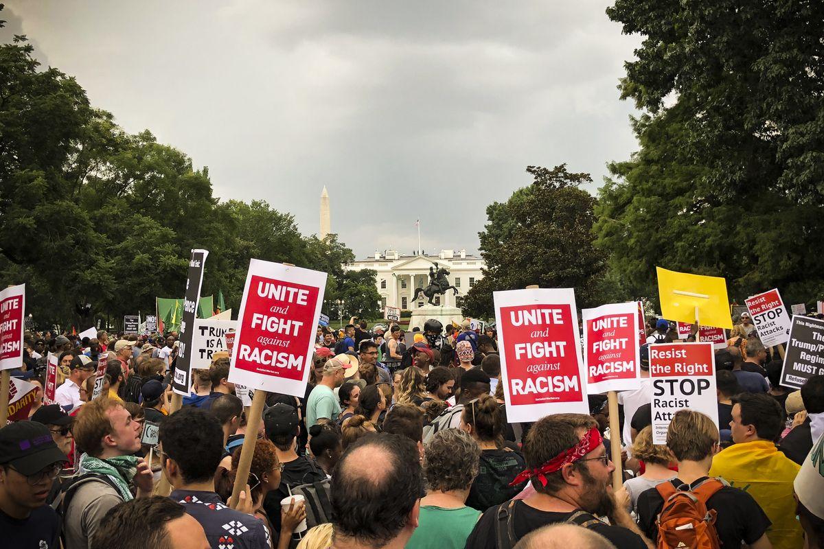 Counter-protestors march against the far-right's Unite the Right 2 rally in Lafayette Square park.