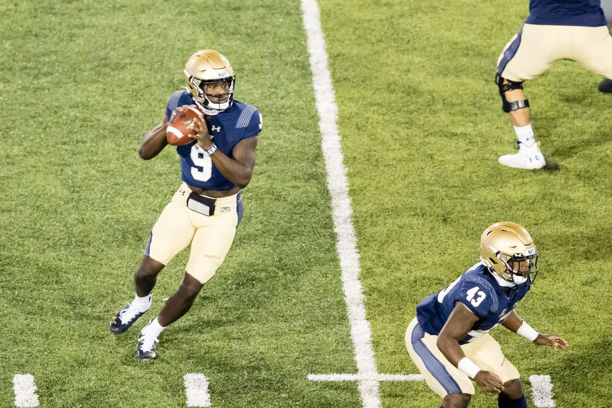Navy quarterback Maasai Maynor (9) drops back to pass during a regular season college football game between the Navy Midshipmen and the Air Force Falcons on October 3, 2020, at Falcon Stadium in Colorado Springs, CO