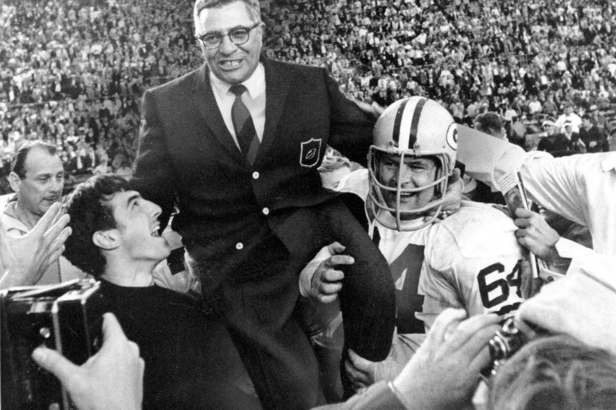 Green Bay Packers coach Vince Lombardi is carried off the field after his team defeated the Oakland Raiders 33 to 14 in the Super Bowl II game in Miami, Fla. on Jan. 14, 1968.