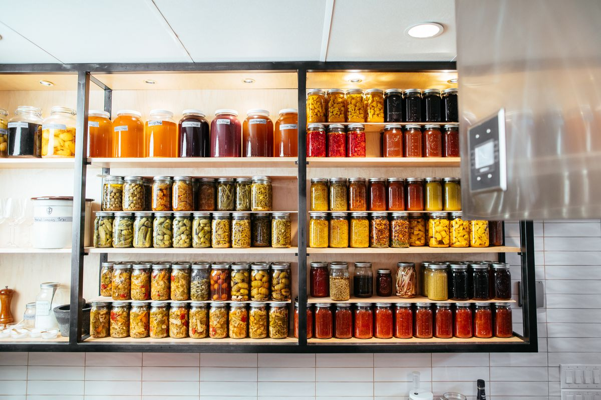 Jars of fermented, canned, and preserved ingredients at Homewood in Dallas