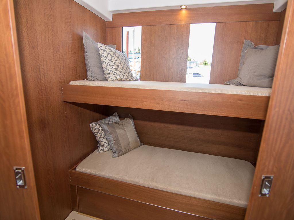 A small wooden alcove with two built-in bunks