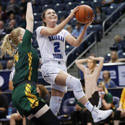 BYU Cougars guard Shaylee Gonzales (2) drives by San Francisco Dons forward Lucija Kostic (24) in Provo on Thursday, Feb. 28, 2019. BYU 82-59.