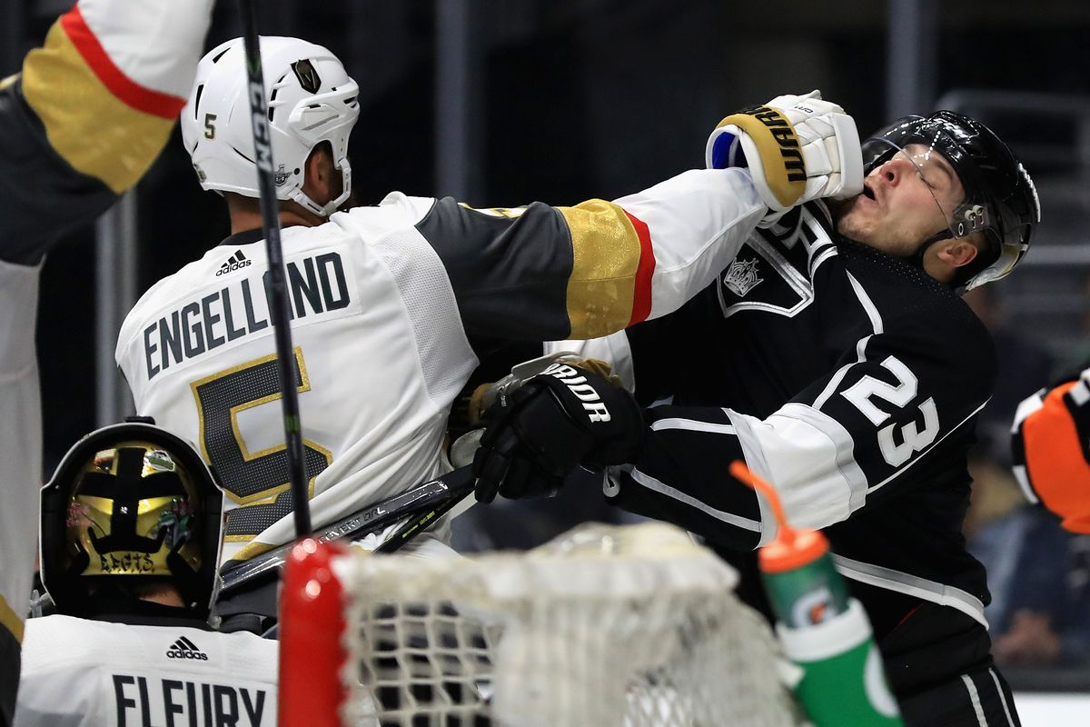 LOS ANGELES, CA - APRIL 15: Deryk Engelland #5 of the Vegas Golden Knights punches Dustin Brown #23 of the Los Angeles Kings during the second period in Game Three of the Western Conference First Round during the 2018 NHL Stanley Cup Playoffs at Staples C